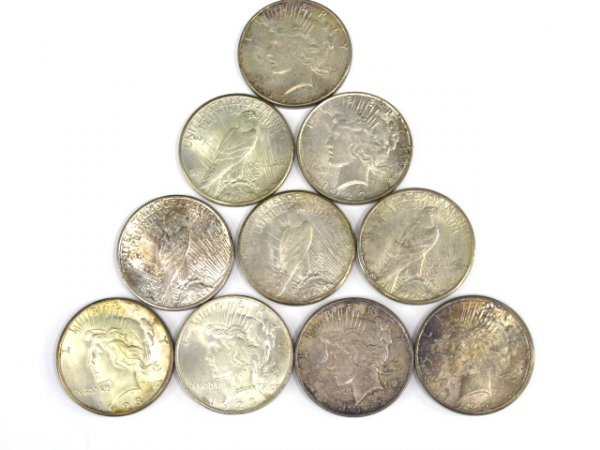 704: LOT OF 10 PEACE SILVER DOLLARS