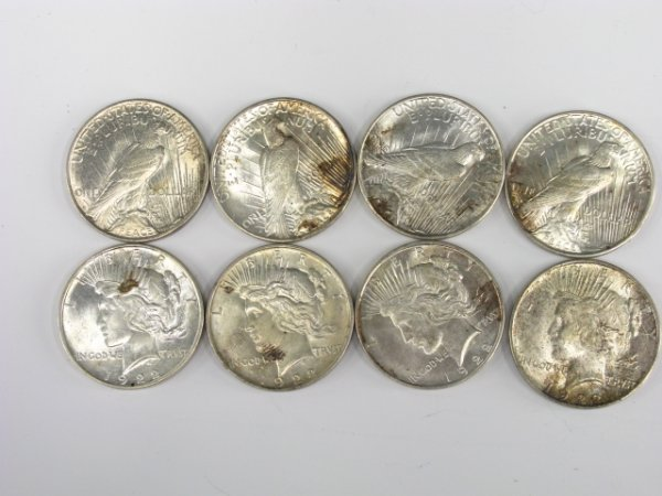 708: LOT OF 8 PEACE SILVER DOLLARS