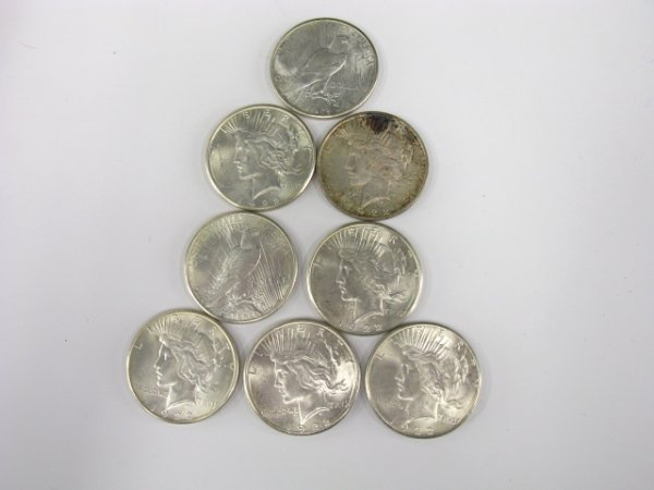 709: LOT OF 8 PEACE SILVER DOLLARS