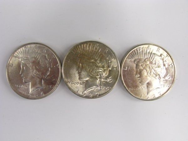 711: LOT OF 3 UNCIRCULATED PEACE SILVER DOLLARS