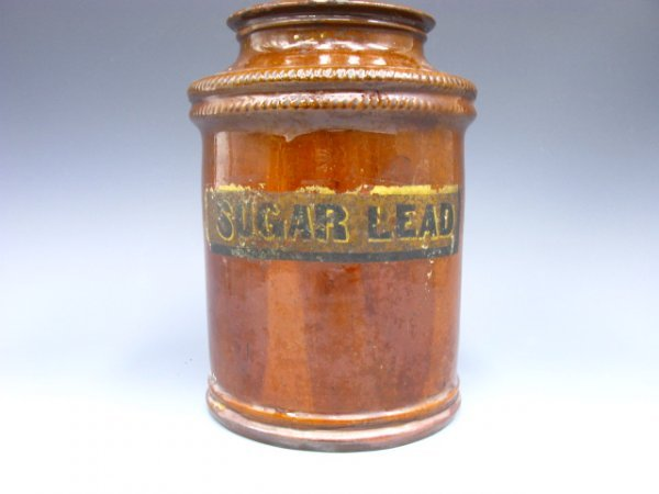 1014: EARLY REDWARE CROCK W/SUGAR LEAD PAINTED LABEL