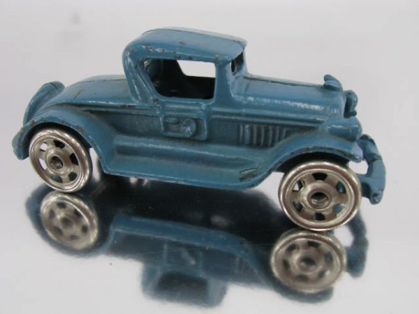 1401: TOY CAR FIVE WHEEL COUPE AUTO SPEEDSTER