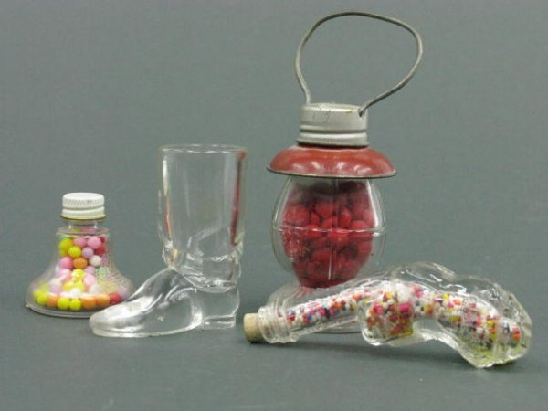 1404: 4 GLASS CANDY CONTAINERS GUN, BOOT, BELL, LANTERN