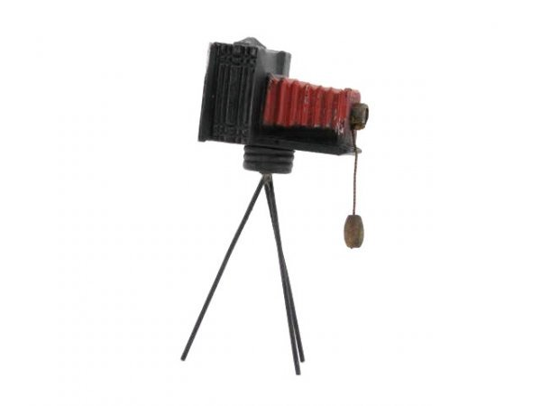 1418: GLASS CANDY CONTAINER CAMERA ON TRIPOD