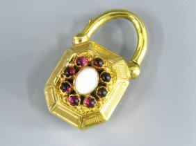 AN ANTIQUE VINAIGRETTE WITH GARNETS & OPALS