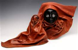 A PAIR OF DRAPED LEATHER SCULPTURES