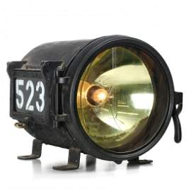 AN ESSCO GOLDEN GLOW LOCOMOTIVE HEADLIGHT WITH CRACK