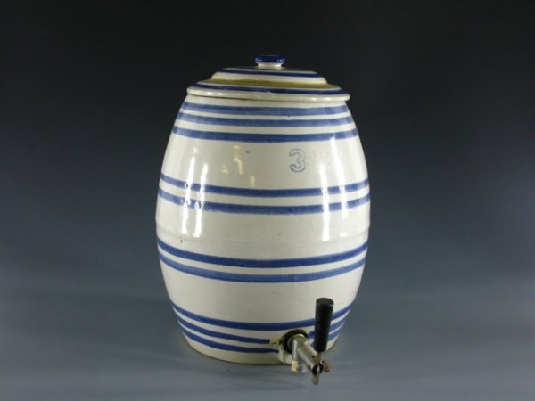 17: A 3 GALLON STONEWARE TEA DISPENSER WITH LID