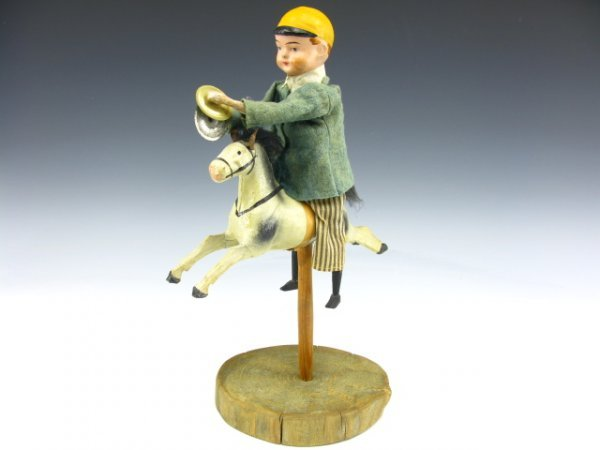 19TH C. PAPIER MACHE BOY ON HORSE PIP SQUEAK TOY