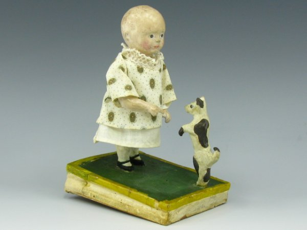 A 19TH C. ANIMATED GIRL & PUPPY PIPSQUEAK TOY