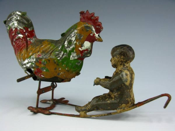 MECHANICAL VICTORIAN TIN TOY BABY FEEDING ROOSTER