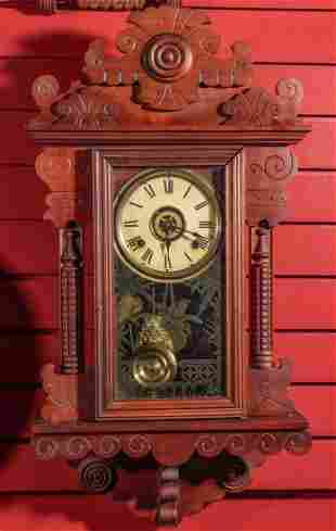 AN UNIDENTIFIED FANCY HANGING CHERRY PARLOR CLOCK