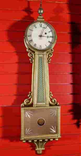 AN EARLY 20TH CENTURY BANJO CLOCK SIGNED E. E. ORVIS