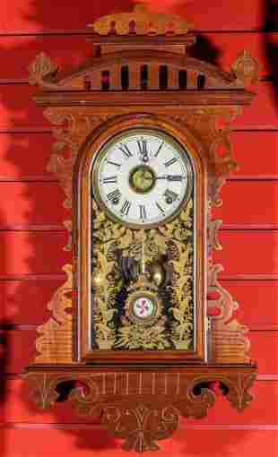 A GOOD E.N. WELCH 'ECLIPSE' FANCY WALNUT PARLOR CLOCK