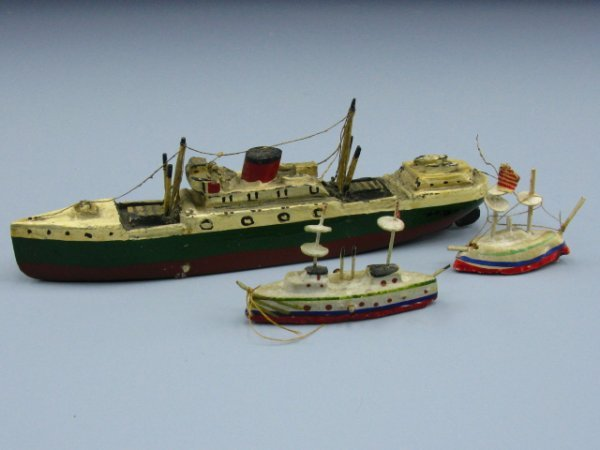 THREE HANDMADE & PAINTED WOODEN SHIPS