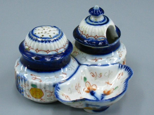 AN ANTIQUE GERMAN PORCELAIN CONDIMENT SET