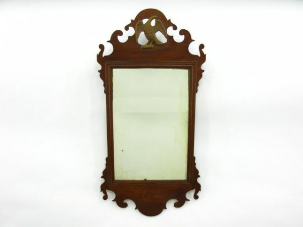 AN EARLY CARVED MAHOGANY MIRROR