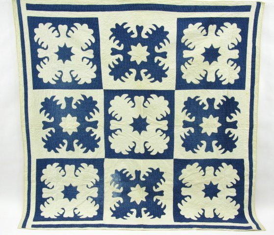 29: CIRCA 1900 REVERSE APPLIQUE BLOCK QUILT