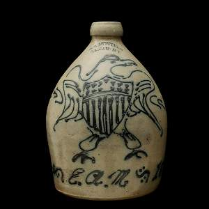 A STONEWARE JUG WITH FEDERAL EAGLE SIGNED E.A. MONTELL