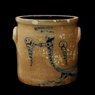 A WOODRUFF BLUE DECORATED CROCK WITH MYTHICAL BIRD