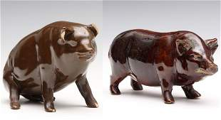 TWO EARLY 20TH C. STONEWARE FACTORY PIG FIGURES