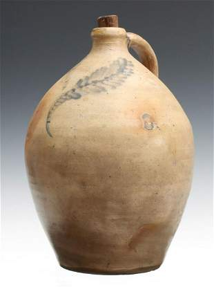 AN EARLY 19TH C. BLUE DECORATED OVOID STONEWARE JUG