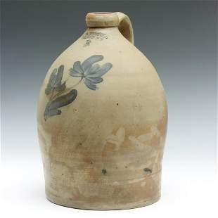 A 19TH CENTURY BLUE DECORATED JUG SIGNED E.A. MONTELL