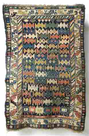 A LIVELY ANTIQUE CAUCASIAN RUG WITH UNUSUAL DESIGN