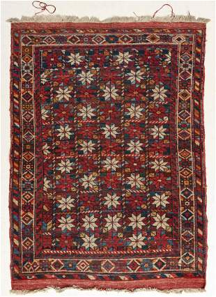 A HANDMADE WOOL PILE ON COTTON ORIENTAL RUG