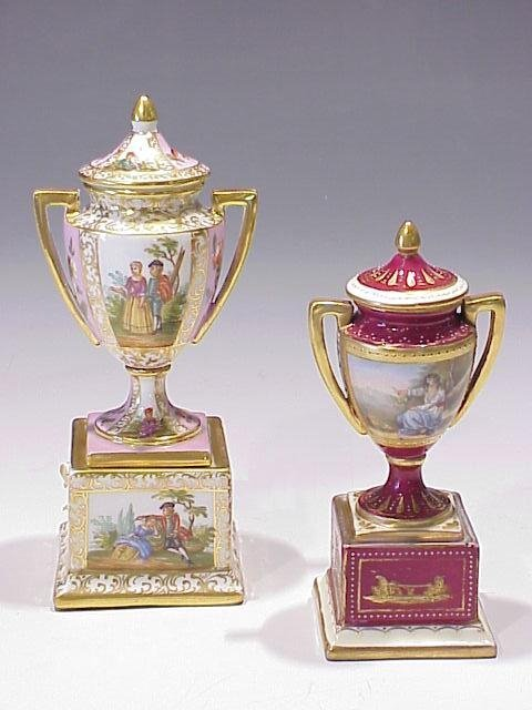 11: Two Small Bolted Covered Cabinet Vases