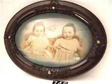 746: CONVEX GLASS ANTIQUE FRAME WITH PHOTO OF TWINS