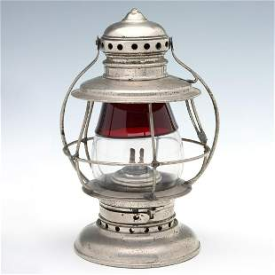 A CONDUCTOR'S RAILROAD LANTERN WITH RED TO CLEAR GLOBE