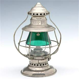 A CONDUCTOR'S RAILROAD LANTERN WITH GREEN/ CLEAR GLOBE