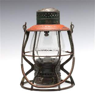 A TALL GLOBE RAILROAD LANTERN MARKED UNION PACIFIC
