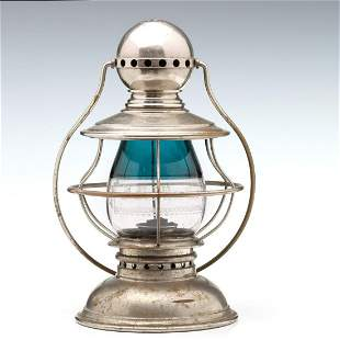A PRESENTATION LANTERN WITH TEAL BLUE OVER CLEAR GLOBE