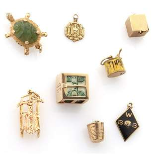 A COLLECTION OF 14K GOLD CHARMS ALONG WITH TURTLE PIN