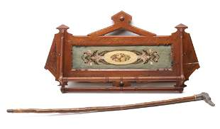 A VICTORIAN WALNUT WALL RACK ALONG WITH DOG HEAD CANE