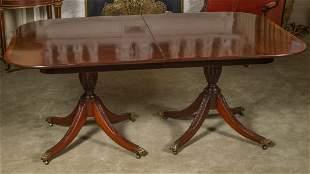 A LATE 20TH CENTURY MAHOGANY REGENCY DINING TABLE