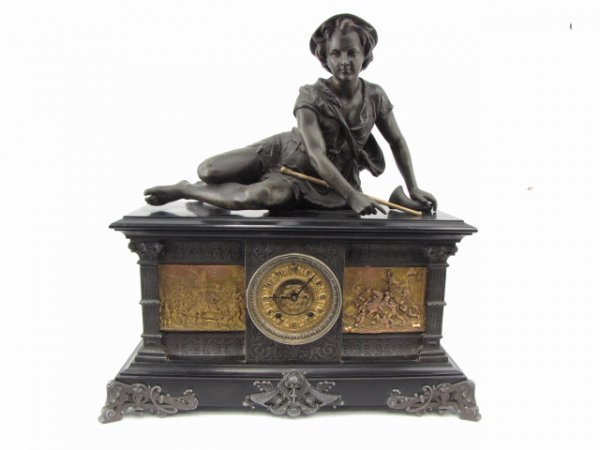 AN ANSONIA 'COLUMBIA' MANTLE CLOCK WITH STATUE