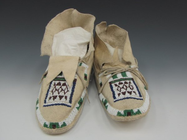PAIR OF SINEW SEWN BEADED CHEYENNE MOCCASINS