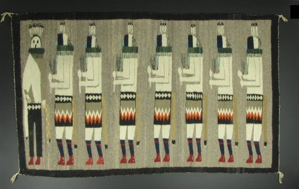 A NAVAJO PICTORIAL RUG WITH MALE DANCER FIGURES