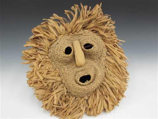 A Iroquois False Face Mask Of Woven Cornhusk