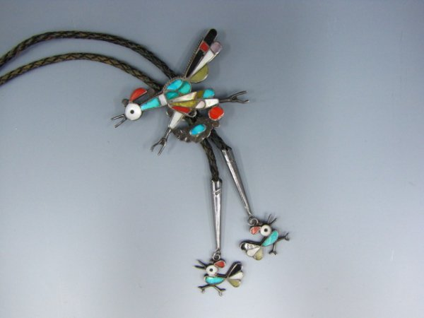 A ZUNI BOLO WITH INLAID ROAD RUNNER