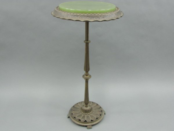 A CAST IRON FERN STAND CIRCA 1920'S WITH GLASS TOP