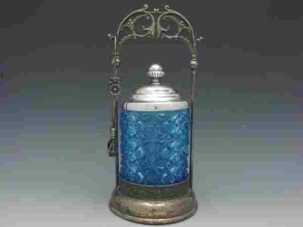 A VICTORIAN PICKLE CASTOR WITH BLUE DAISY AND BUTTON IN