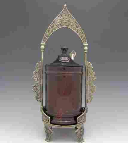 A VICTORIAN PICKLE CASTOR WITH RUBY GLASS INSERT