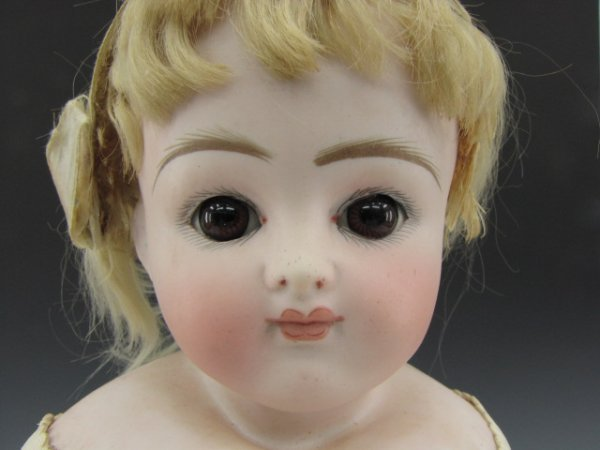 AN ANTIQUE FRENCH BISQUE HEAD DOLL