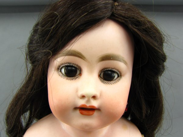 AN ANTIQUE BISQUE HEAD DOLL FOR THE FRENCH MARKET