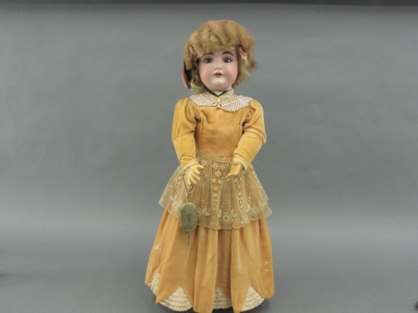 A 28 INCH BISQUE HEAD DOLL ATTRIBUTED TO KESTNER