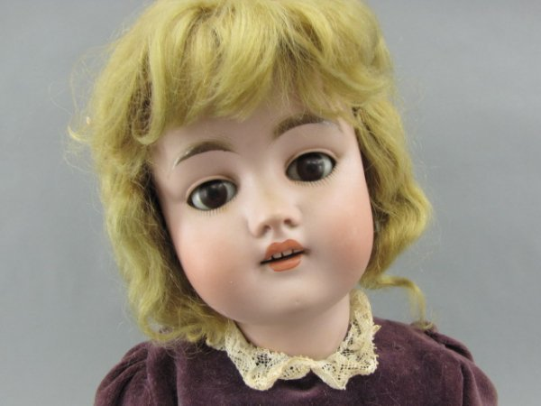 A 22 INCH GERMAN DOLL ATTRIBUTED TO  KESTNER